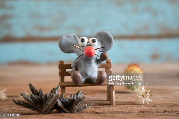 rat from plasticine,cartoon style.the background is blue wood panels. - brown cartoon characters stock pictures, royalty-free photos & images
