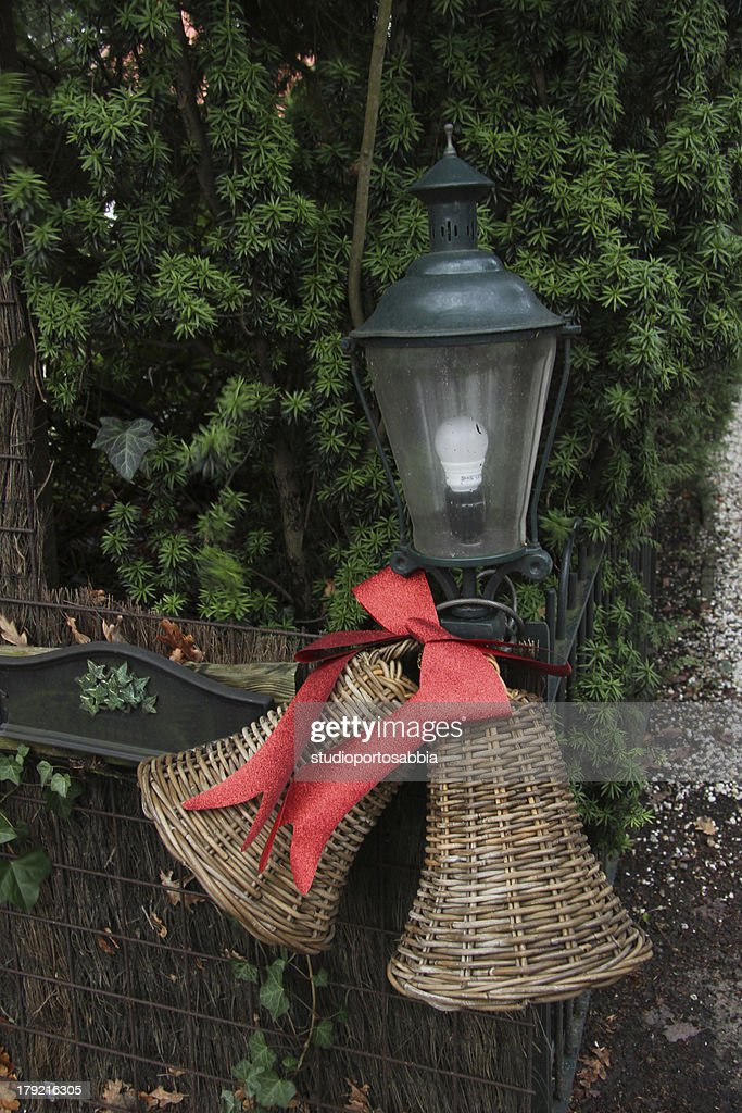 ratan christmas decorations on a fence stock photo