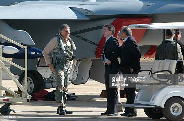 Ratan Tata chairman of Tata Group talks with fellows before his ride on an F18 fighter plane during the Aero India 2007 in Bangalore India on Friday...