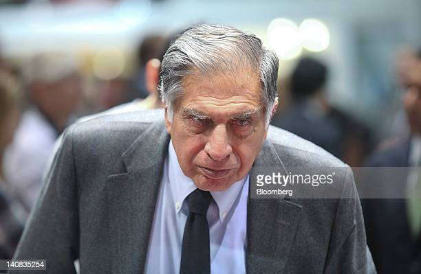 Ratan Tata chairman of Tata Motors Ltd looks at automobile stands on the second press day of the Geneva International Motor Show in Geneva...