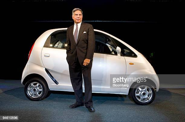 Ratan Tata chairman of the Tata Group poses with Tata Motors Ltd's new Nano car at the Auto Expo 2008 in New Delhi India on Thursday Jan 10 2008...