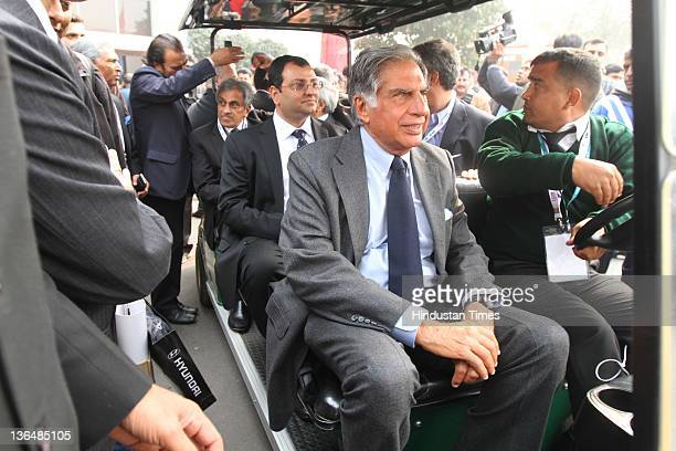 Ratan Tata Chairman Tata group and Chairman designate and vice chairman Cyrus Mistry ride in an open vehicle during 11th Auto Expo 2012 at Pragati...