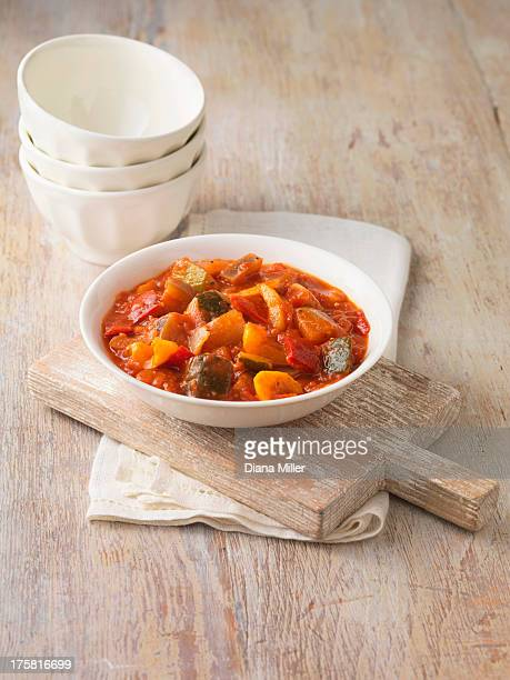 Ratatouille in white bowl. Garlic, onions, tomatoes and courgettes