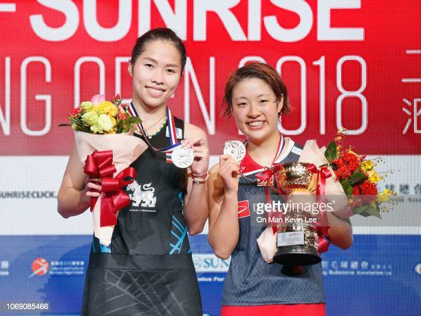 Ratchanok Intanon of Thailand and Nozomi Okuhara of Japan poses with their trophies after the final of Women's Single of Yonex Sunrise Hong Kong Open...