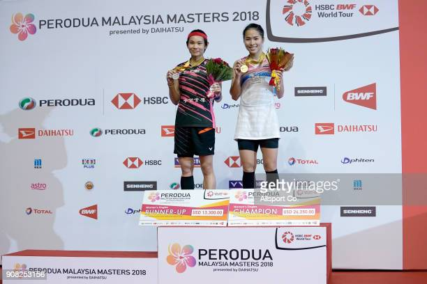 Ratchanok Intanon of Thailand and Tai Tzu Ying of Chinese Taipei poses with their winners' medals during the Women's Singles Final during the Perodua...