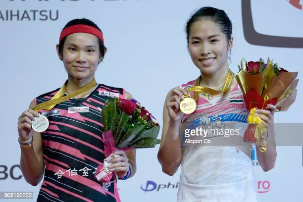 Ratchanok Intanon of Thailand and Tai Tzu Ying of Chinese Taipei pose with their winners' medals during the Women's Singles Final during the Perodua...