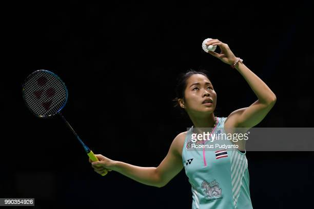 Ratchanok Intanon of Thailand competes against Fitriani of Indonesia during Women's Singles Round 1 on day one of the Blibli Indonesia Open at Istora...