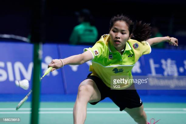 Ratchanok Intanon of Thailand competes against Hui Xirui of China during the women's singles match on day three of China Open 2013 at Yuanshen...