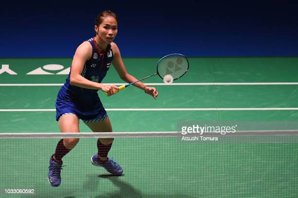 Ratchanok Intanon of Thailand competes in the Women's Singles quarter final match against Carolina Marin of Spain on day four of the Yonex Japan Open...