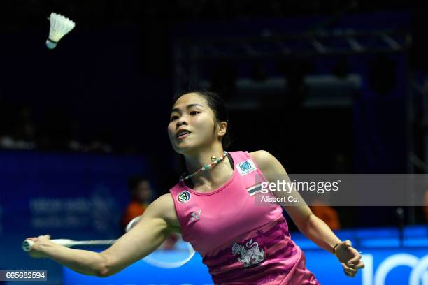 Ratchanok Intanon of Thailand plays a return shot to Carolina Marin of Spain during the women's singles quarter final of the 2017 World BWF Super...