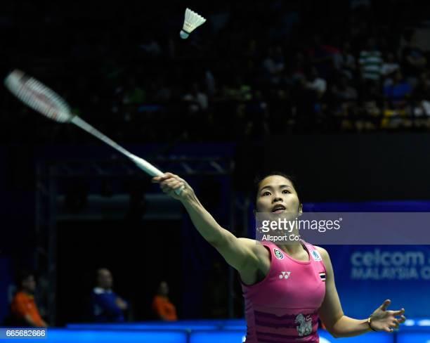 KUCHING SARAWAK MALAYSIA APRIL 07 Ratchanok Intanon of Thailand plays a return shot to Carolina Marin of Spain during the women's singles quarter...