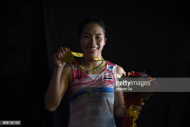 Ratchanok Intanon of Thailand poses with her gold medal after she defeated Tai Tzu Ying of Chninese Taipei during the Women's Singles Final during...