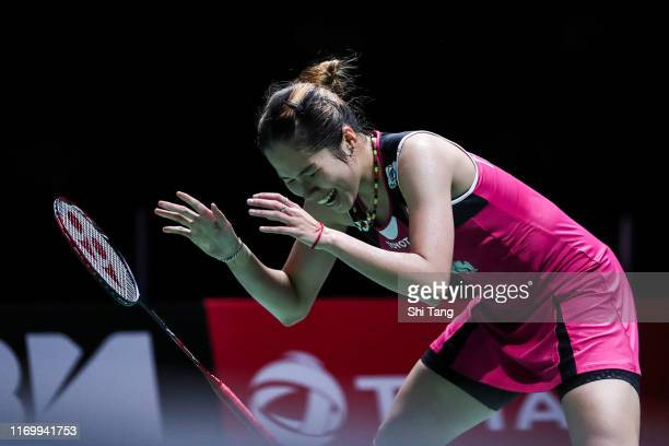 Ratchanok Intanon of Thailand reacts in the Women's Singles semi finals match against Nozomi Okuhara of Japan during day six of the Total BWF World...