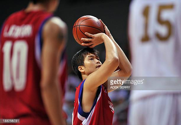 Ratdech Kruativa of Thailand aims to shoot the ball as they compete against Indonesia team during the second semifinal basketball men's team at the...