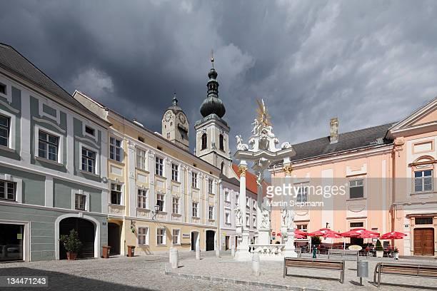 Rathausplatz square with Johannes Nepomuk monument, steeples of Frauenbergkirche Church and the Church of St Nicholas, Stein, Wachau valley, Waldviertel region, Lower Austria, Austria, Europe