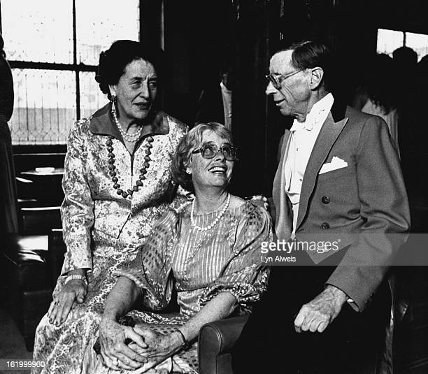 Rathbone Falck commands total attention from Mrs. Tweet Kimball of Cherokee Ranch, Sedalia, left, and Mrs. B. Ranger Rogers.;