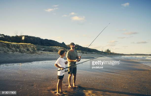 rather teach them instead of just giving - candid beach stock photos and pictures
