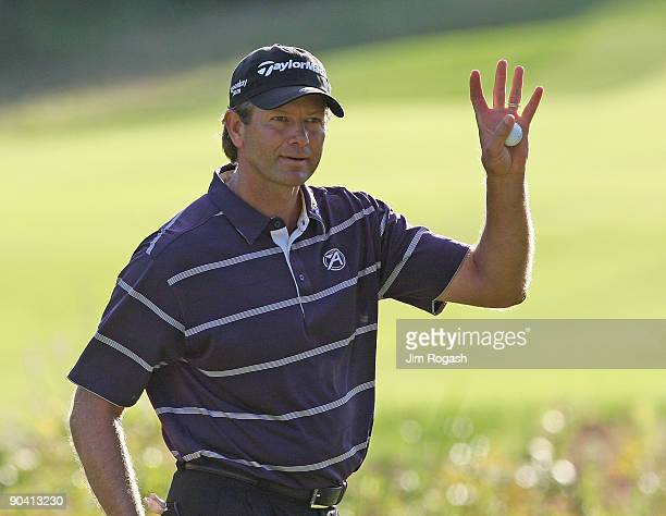 Ratief Goosen reacts on the 18th green during the third round of the Deutsche Bank Championship held at TPC Boston on September 6, 2009 in Norton,...