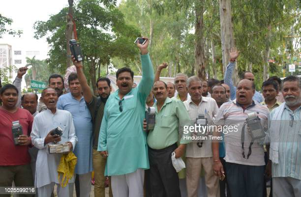 Ration dealers stage protest at district headquarters and declare to shutdown their shops and also demand scrapping of FIRs lodged against them on...