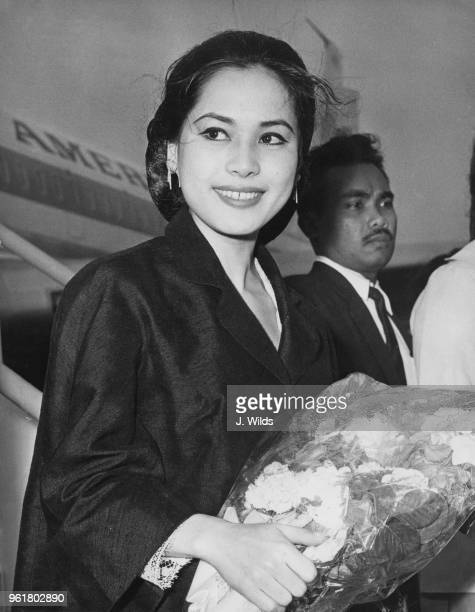Ratna Sari Dewi Sukarno the wife of Indonesian President Sukarno arrives at London Airport on her first visit to London 25th June 1965 She is in the...