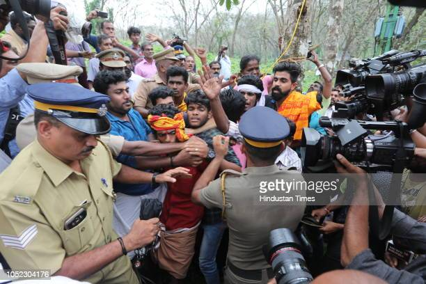 Ratnaamma a Hindu devotee is surrounded by other devotees as she threatens to commit suicide in protest against the lifting of ban by the Supreme...