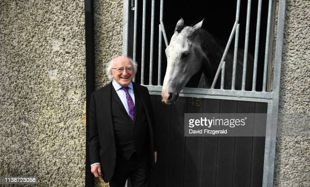 Ratoath Ireland 22 April 2019 President of Ireland Michael D Higgins meets Whisper In The Breeze a horse trained by Jessica Harrington during the...