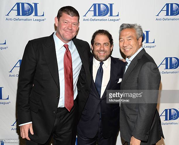 RatPac Entertainment's James Packer and Brett Ratner and Warner Bros Entertainment CEO Kevin Tsujihara attend the AntiDefamation League's 2015...
