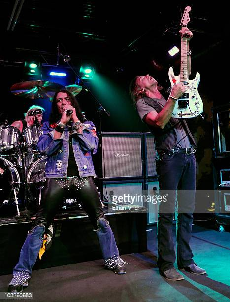 Ratt drummer Bobby Blotzer singer Stephen Pearcy and guitarist Warren DeMartini perform at the Monte Carlo Resort and Casino August 5 2010 in Las...