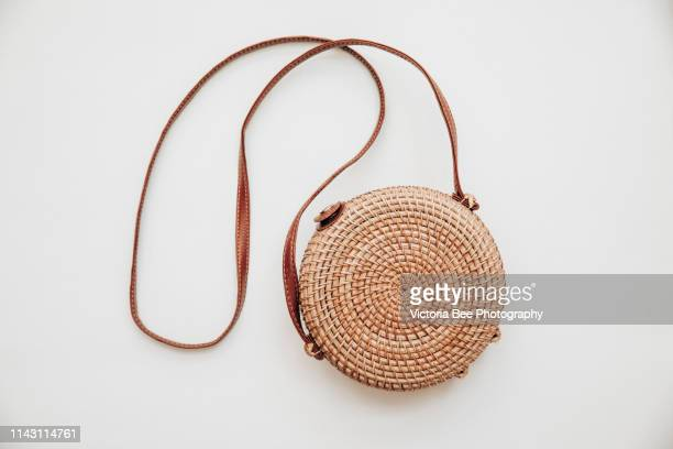 rattan bamboo trendy woman bag - clutch bag stock pictures, royalty-free photos & images