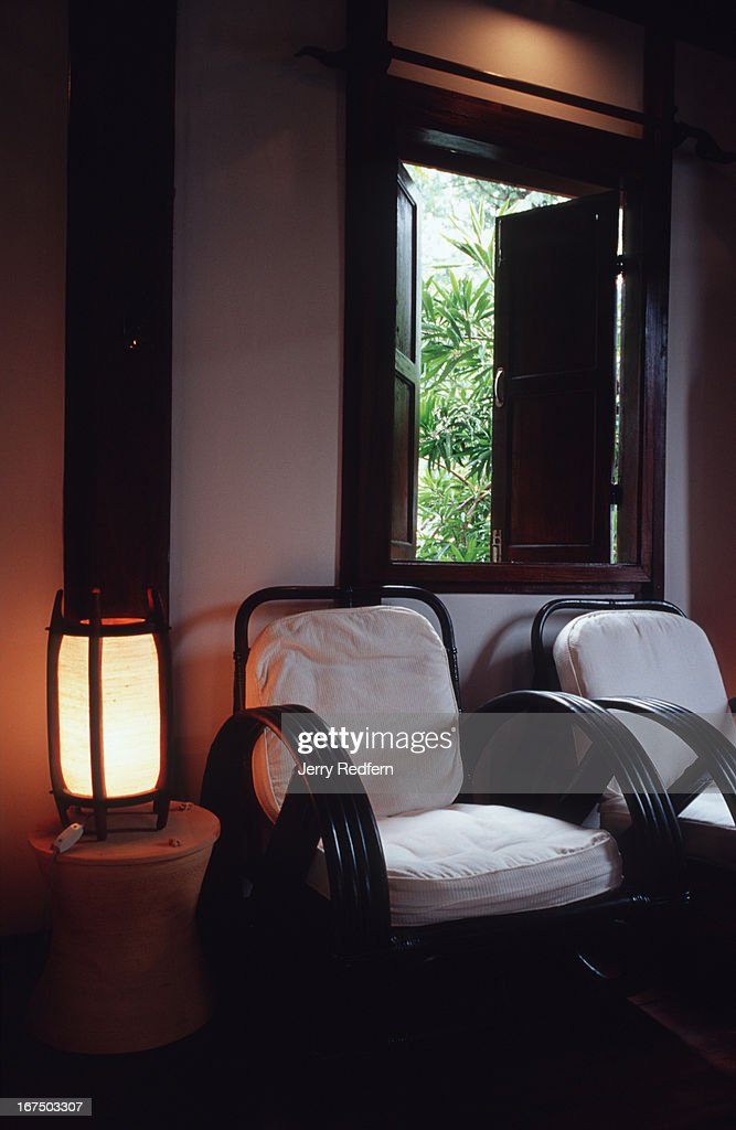 subtle lighting. Rattan Chairs With Comfy Cotton Pillows, Subtle Lighting And Views Of Surrounding Foliage Are On