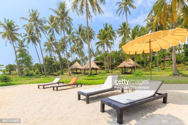 rattan weave daybed chair on tropical white sand beach. - chaise longue stock photos and pictures