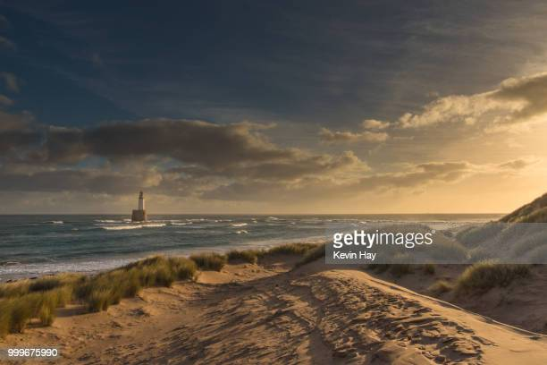 rattray head basking in winter sun - rattray head stock pictures, royalty-free photos & images