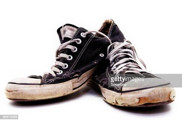 Ratty, old pair of black converse sneakers