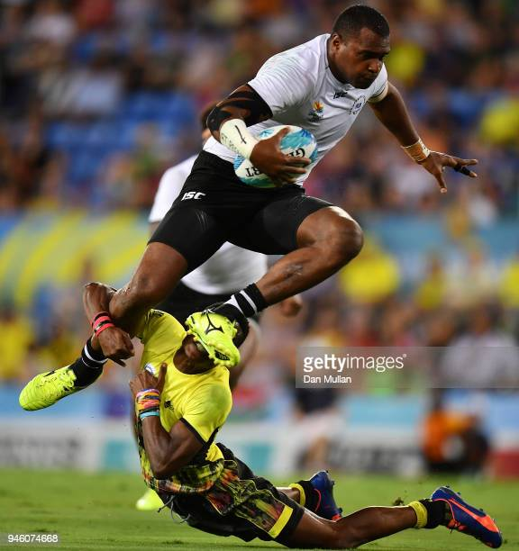 Ratu Vakurinabili of Fiji is tackled by Adrian Kasito of Uganda during the Rugby Sevens Men's Pool D match between Fiji and Uganda on day 10 of the...