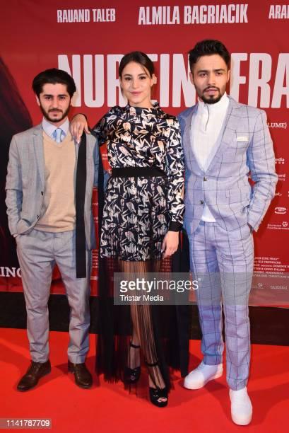 Rauand Taleb, Almila Bagriacik and Aram Arami attend the 'Nur eine Frau' premiere at Kino International movie theater on May 6, 2019 in Berlin,...