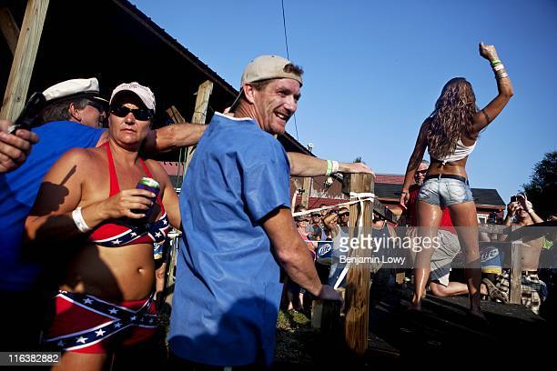 A raucous crowd cheers during a wet tshirt contest following the completion of the Redneck Fishing Contest on August 7 2010 in Bath IL The contest a...