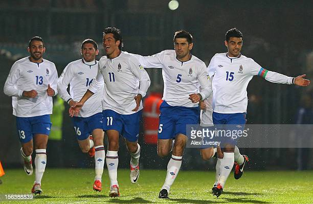 Rauf Aliyev of Azerbaijan celebrates with team mates after scoring the opening goal during the FIFA 2014 World Cup Group F Qualifying match between...