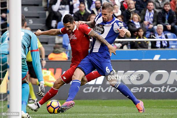 Raul Albentosa of Deportivo de la Coruña compete for the ball against Vitolo Machín of Sevilla FC during the La Liga Santander match between Real...