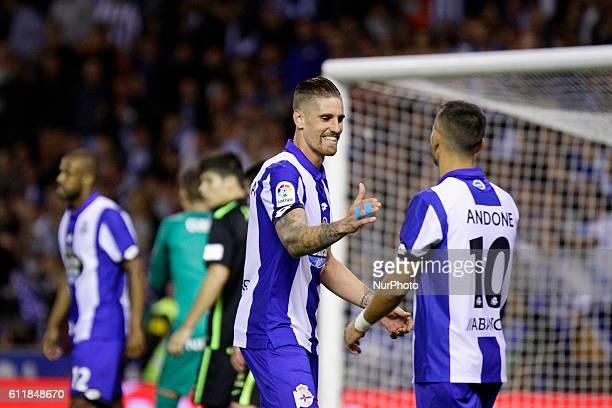 Raul Albentosa of Deportivo de la Coruna and Florin Andone of Deportivo de la Coruna react during the La Liga Santander match between Real Club...