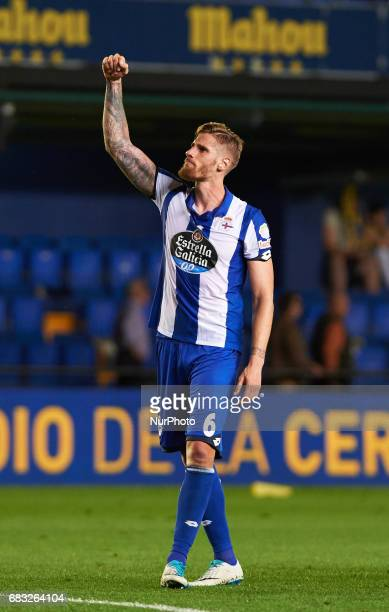 Raul Albentosa of Deportivo de la Coruna celebrates their stay in the first division another year more during their La Liga match between Villarreal...