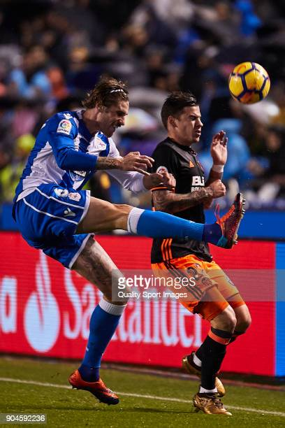 Raul Albentosa of Deportivo de La Coruna competes for the ball with Santi Mina of Valencia CF during the La Liga match between Deportivo La Coruna...