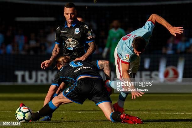 Raul Albentosa of Deportivo de La Coruna competes for the ball with Lucas Boye of Celta de Vigo during the La Liga match between Celta de Vigo and...