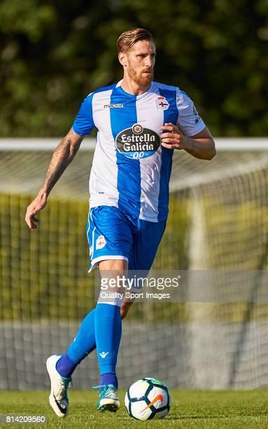 Raul Albentosa of Deportivo de La Coruna runs with the ball during the preseason friendly match between Deportivo de La Coruna and Racing Villalbes...