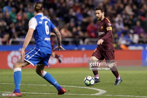 Raul Albentosa of Deportivo La Coruna Lionel Messi of FC Barcelona during the La Liga Santander match between Deportivo la Coruna v FC Barcelona at...