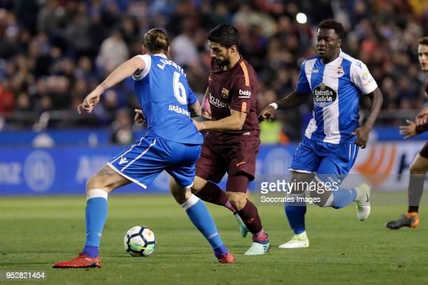 Raul Albentosa of Deportivo La Coruna Luis Suarez of FC Barcelona during the La Liga Santander match between Deportivo la Coruna v FC Barcelona at...