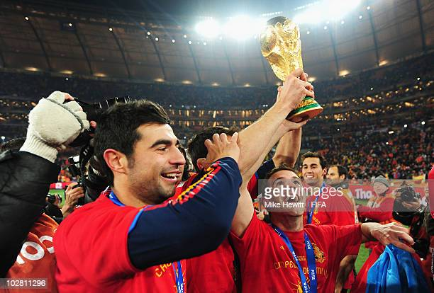 Raul Albiol and Juan Manuel Mata of Spain celebrate with the World Cup during the 2010 FIFA World Cup South Africa Final match between Netherlands...