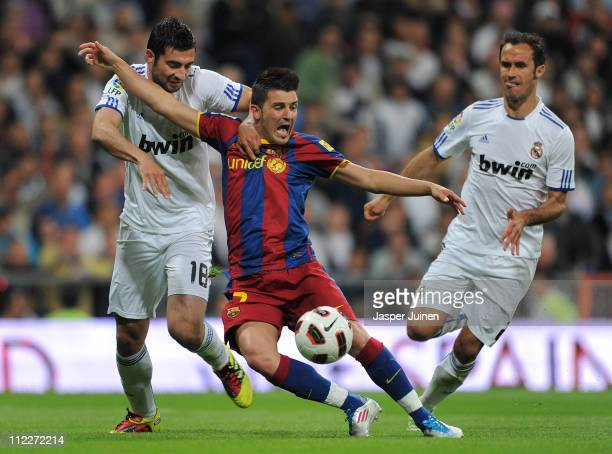 Raul Albiol of Real Madrid fouls David Villa of Barcelona in the penalty aeria as Ricardo Carvalho looks on during the la Liga match between Real...