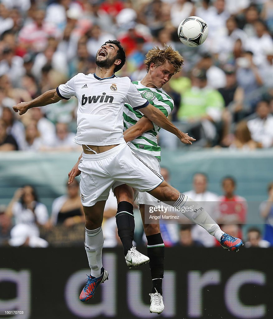 Raul Albiol of Real Madrid jumps for a high ball against Thoma Rogne of Celtic during a World Football Challenge match between Celtic and Real Madrid at Lincoln Financial Field on August 11, 2012 in Philadelphia, Pennsylvania.