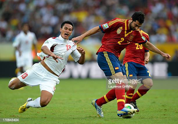 Raul Albiol of Spain competes with Steevy Chong Hue of Tahiti during the FIFA Confederations Cup Brazil 2013 Group B match between Spain and Tahiti...