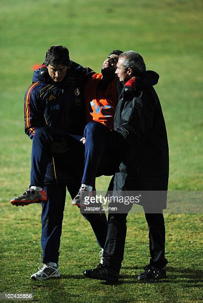 Raul Albiol of Spain is carried off the pitch after injuring himself during a training session on June 26, 2010 in Potchefstroom, South Africa.